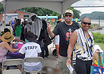 Volunteers at work greeting and admitting  attenders arriving at the Jazz in the Valley Festival, in Waryas Park in Poughkeepsie, NY, on Sunday, August 21, 2016. Photo by Jim Peppler. Copyright Jim Peppler 2016 all rights reserved.