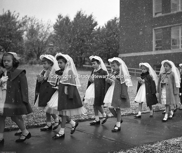 Bethel Park PA:  View of young catholic girls walking to church to receive their first holy communion at Saint Valentine's Church in Bethel Park PA - 1954.  Cathy Stewart was part of the class that received their first holy communion in 1954.  St Valentine's school opened in 1953 and is still in operation today.  Brady and Cathy Stewart attended the school from 1st thru 8th grades.  Michael Stewart attended from 1st thru 3rd grades.  He left and went to Hillcrest Elementary school after a disagreement with one of the nuns over a tuna fish sandwich!