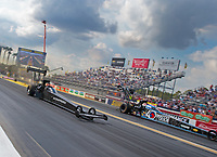 Mar 15, 2019; Gainesville, FL, USA; NHRA top fuel driver Mike Salinas (near) races alongside Antron Brown during qualifying for the Gatornationals at Gainesville Raceway. Mandatory Credit: Mark J. Rebilas-USA TODAY Sports