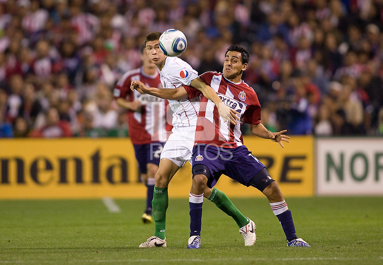 Chivas de Guadalajara forward Michel Vazquez battles Chivas USA midfielder Jesus Padilla. Chivas USA and CD Chivas de Guadalajara played to 0-0 draw at Petco Park stadium in San Diego, California on Tuesday September 14, 2010.