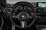 Car pictures of steering wheel view of a 2018 BMW M4 Base 2 Door Coupe
