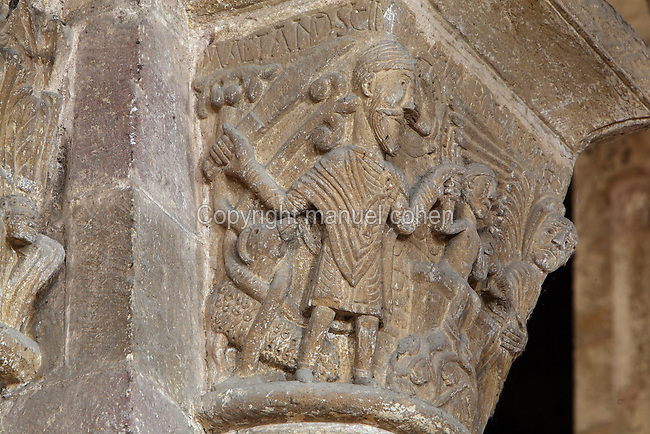 Carved capital depicting Abraham holding a knife about to sacrifice his son Isaac, with an angel on the far right, in the transept of the Abbatiale Sainte-Foy de Conques or Abbey-church of Saint-Foy, Conques, Aveyron, Midi-Pyrenees, France, a Romanesque abbey church begun 1050 under abbot Odolric to house the remains of St Foy, a 4th century female martyr. The church is on the pilgrimage route to Santiago da Compostela, and is listed as a historic monument and a UNESCO World Heritage Site. Picture by Manuel Cohen