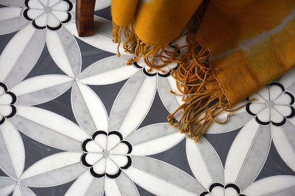 Edie, a natural stone waterjet mosaic shown in Nero Marquina, Bardiglio, Thassos, and Carrara, is part of the Silk Road Collection by New Ravenna.