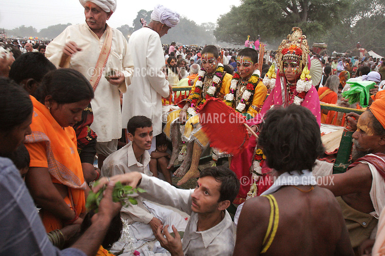 .RAMNAGAR, UTTAR PRADESH, INDIA - OCTOBER 2, 2005 : Priests carry the svarups (young boys who portrait the Gods) for the play Ramlila (Lila=play in Hindi) in Ramnagar (Nagar=neighborhood) . The Ramlila is the play of the Hindu scripture 'the Ramayana' which depict the adventures of the god Ram and his flight aginst the Demon God Ravana. The Ramlila of Ramnagar has been organized by the Maharaja of Benares since the early 1800s and is still the most authentic, a reference to other Ramlilas. The It last for 31 days over a 10 square mile area and is still the largest play to be produced in the world .(Photo by Jean-Marc Giboux/Getty Images)