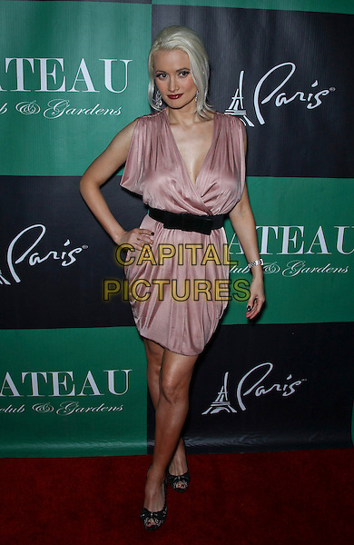 Holly Madison.walks the red carpet at Chateau Nightclub and Gardens inside Paris Las Vegas,  Las Vegas, Nevada, USA, .25th May 2012..full length pink dress black belt bow silk satin sleeveless hands on hips peep toe shoes .CAP/ADM/MJT.© MJT/AdMedia/Capital Pictures.