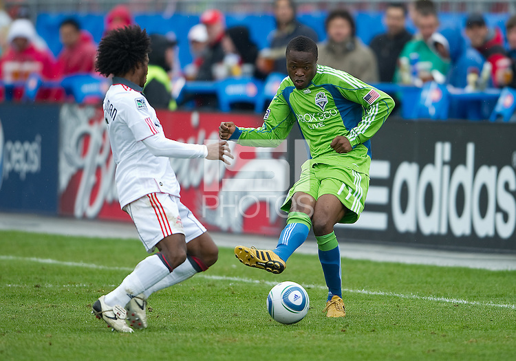 25 April 2010: Seattle Sounders forward Steve Zakuani #11 attempts to kick the ball past Toronto FC midfielder Julian de Guzman #6 during a game between the Seattle Sounders and Toronto FC at BMO Field in Toronto..Toronto FC won 2-0....
