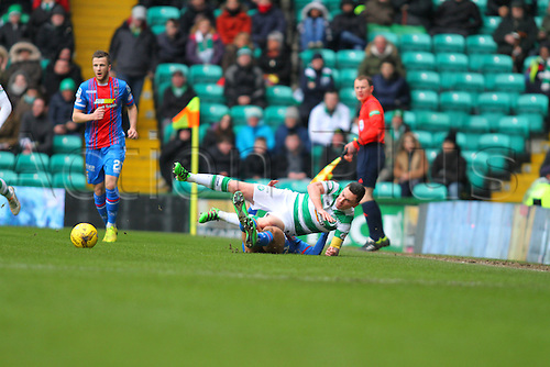 20.02.2016. Celtic Park, Glasgow, Scotland. Scottish Premier League. Celtic versus Inverness CT. Scott Brown is tackled by Lewis Horner