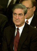 Washington, DC - January 28, 2003 -- United States Federal Bureau of Investigation (FBI) Director Robert Mueller listens as United States President George W. Bush delivers his State of the Union Address to a Joint Session of the United States Congress.<br /> Credit: Ron Sachs / CNP
