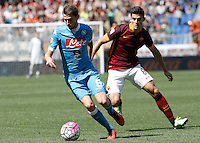 Calcio, Serie A: Roma vs Napoli. Roma, stadio Olimpico, 25 aprile 2016.<br /> Napoli&rsquo;s Jorginho, left, is chased by Roma&rsquo;s Diego Perotti during the Italian Serie A football match between Roma and Napoli at Rome's Olympic stadium, 25 April 2016. <br /> UPDATE IMAGES PRESS/Isabella Bonotto