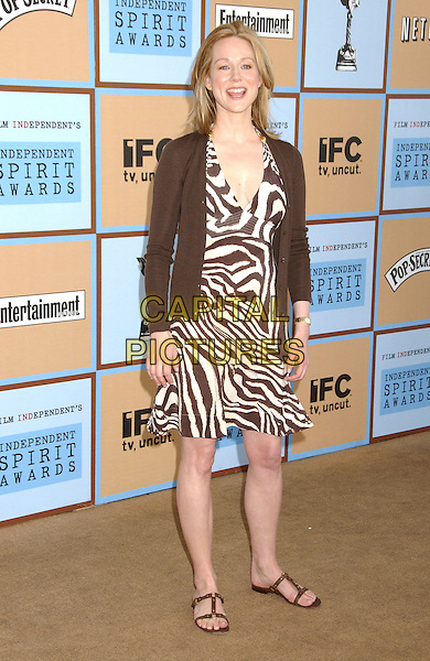 LAURA LINNEY.At the 21st IFP Film Independants's Independent Spirit Awards held at Santa Monica Beach, Santa Monica, California, USA,04 March 2006..full length brown zebra animal print dress.Ref: ADM/LF.www.capitalpictures.com.sales@capitalpictures.com.©Laura Farr/AdMedia/Capital Pictures.