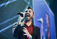 NWA Democrat-Gazette/CHARLIE KAIJO Tyler Glenn of Neon Trees performs during the Walmart shareholders meeting, Friday, June 7, 2019 at the Bud Walton Arena in Fayetteville.