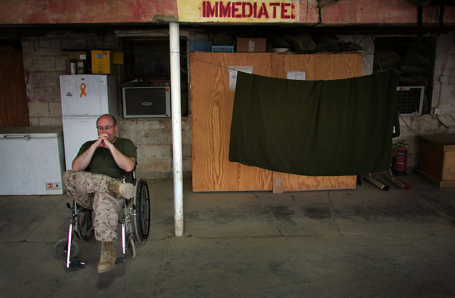Commander Joseph Rappold waits for incoming patients in the casualty drop-off area at Ramadi Surgical - a joint Army-Naval surgical unit at Camp Ramadi - on Thursday August 10, 2006. Commander Rappold is the commanding officer for the unit. For its size the surgical unit is the busiest in the country..