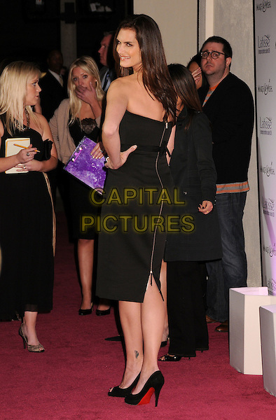 BROOKE SHIELDS.Launch Party for LATISSE held at a private gallery, Los Angeles, California, USA..March 26th, 2009.full length black dress strapless hand on hip looking over shoulder zip zipper .CAP/ADM/BP.©Byron Purvis/AdMedia/Capital Pictures.