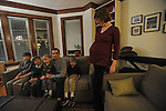Jon Dodson, 32, and Meagan Francis, 31, with their four children (l-r) Jacob Dodson, 11, Isaac Dodson, 9, William Dodson, 5, and Owen Dodson, 3, at the home of one of Jon's colleague's in Evanston, Illinois on February 4, 2009. Francis is pregnant with her fifth child.
