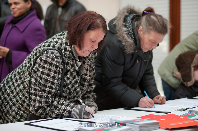 Local residents sign the petition at the launch of the campaign for a Queen's Park Community Council at the Beethoven Centre, West London.
