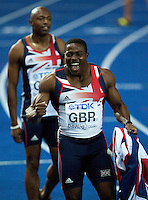 22 AUG 2009 - BERLIN, GER - Harry Aikines Aryeetey (GBR) celebrates taking the team to a silver medal in the Mens 4 x 100m Relay Final at the World Athletics Championships .(PHOTO (C) NIGEL FARROW)