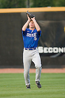 Right fielder Brian Litwin #5 of the Duke Blue Devils catches a fly ball against the Wake Forest Demon Deacons at the Wake Forest Baseball Park April 23, 2010, in Winston-Salem, NC.  Photo by Brian Westerholt / Sports On Film