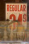 Regular gasoline price sign in an old window: 34.9¢ per gallon. Victor, Colorado.