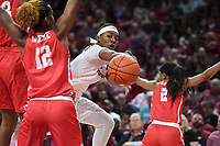 NWA Democrat-Gazette/J.T. WAMPLER Arkansas' A'Tyanna Gaulden passes the ball past Houston's Alyssa Okoene Thursday March 21, 2019 at Bud Walton Arena in Fayetteville during the first round of the Women's National Invitational Tournament.