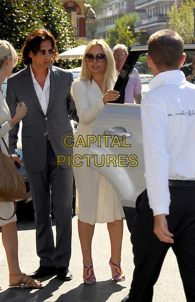 STEFANO PICCOLO & ORNELLA MUTI.arrive at the Hotel Excelsior during 66th Venice International Film Festival, Lido, Venice, Italy, 6th September 2009..full length white cream jacket skirt  grey gray suit sunglasses bag grey gray shoes sandals multi-coloured open toe getting into car .CAP/RD .©Richard Dean/Capital Pictures
