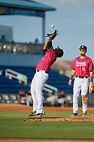 Pensacola Blue Wahoos pitcher Edwar Colina (26) catches a popup during a Southern League game against the Mobile BayBears on July 25, 2019 at Blue Wahoos Stadium in Pensacola, Florida.  Pensacola defeated Mobile 2-1 in the first game of a doubleheader.  (Mike Janes/Four Seam Images)