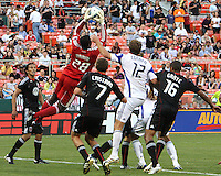 Bill hamid #28 of D.C.United  grabs the ball in front of Jimmy Conrad #12 of the Kansas City Wizards during an MLS match at RFK Stadium on May 5 2010, in Washington DC. United won 2-1