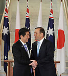 AUSTRALIA, Canberra : Japanese Prime Minister Shinzo Abe (L) shakes hands with Australian Prime Minister Tony Abbnott (R) after signing the visitors book at Parliament House in Canberra on July 8, 2014. Defence ties are set to take centre stage when Australia plays host to Japanese Prime Minister Shinzo Abe this week, as the two countries look set to strengthen their relationship through annual leaders' meetings. AFP PHOTO / Mark GRAHAM