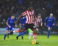 Lincoln City's John Akinde scores his side's second goal from the penalty spot<br /> <br /> Photographer Andrew Vaughan/CameraSport<br /> <br /> The EFL Sky Bet League Two - Saturday 15th December 2018 - Lincoln City v Morecambe - Sincil Bank - Lincoln<br /> <br /> World Copyright © 2018 CameraSport. All rights reserved. 43 Linden Ave. Countesthorpe. Leicester. England. LE8 5PG - Tel: +44 (0) 116 277 4147 - admin@camerasport.com - www.camerasport.com