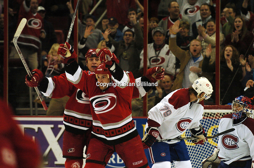 Montreal Canadiens' goaltender Jose Theodore and teammate Andrei Markov (79) of Russia watch as the Carolina Hurricanes' Cory Stillman, center, and Rod Brind'Amour, left, celebrate Stillman's goal during their game Saturday, Dec. 31, 2005 in Raleigh, NC. Carolina won 5-3.