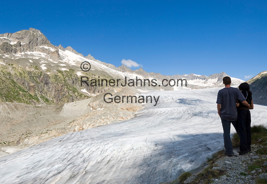 Switzerland, Canton Valais, Rhone Glacier with Gaerstenhoerner mountains above Furka Pass Road - couple
