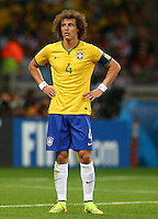 David Luiz of Brazil stands with his hands on his hips