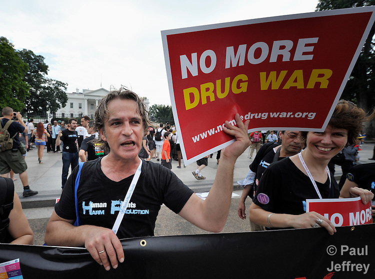 Protestors demonstrate outside the White House on July 24, 2012, criticizing U.S. government support for pharmaceutical companies which have resisted generic licenses for their drugs for people living with HIV and AIDS. The protest took place during the XIX International AIDS Conference.