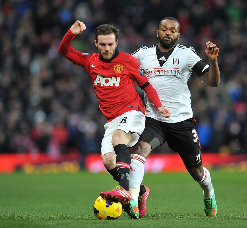 Manchester United's Juan Mata shields the ball from Fulham's Darren Bent<br /> <br /> Photo by Dave Howarth/CameraSport<br /> <br /> Football - Barclays Premiership - Manchester United v Fulham - Sunday 9th February 2014 - Old Trafford - Manchester<br /> <br /> &copy; CameraSport - 43 Linden Ave. Countesthorpe. Leicester. England. LE8 5PG - Tel: +44 (0) 116 277 4147 - admin@camerasport.com - www.camerasport.com