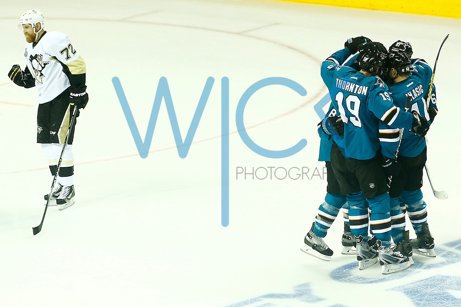 Justin Braun #61 of the San Jose Sharks celebrates his goal with teammates in the first period against the Pittsburgh Penguins during game three of the Stanley Cup Final at the SAP Center in San Jose, California on June 4, 2016. (Photo by Jared Wickerham / DKPS)