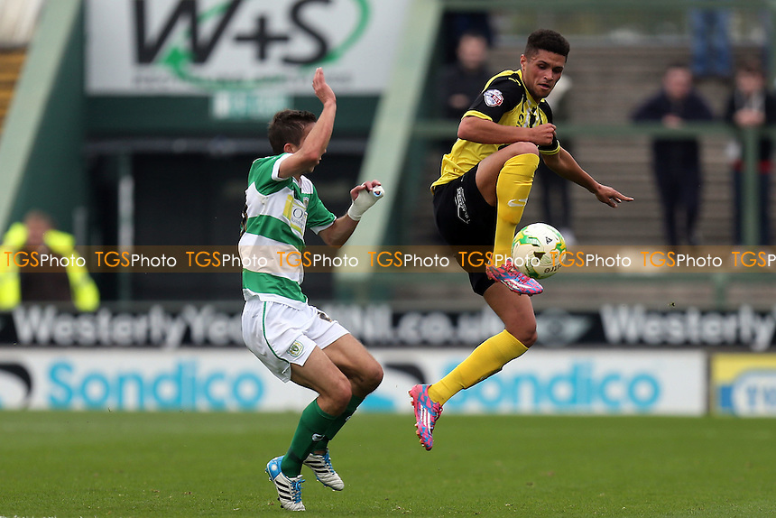 Wes Fogden of Yeovil Town and Kane Ferdinand of Dagenham during Yeovil Town vs Dagenham and Redbridge, Sky Bet League 2 Football at Huish Park, Yeovil, England on 10/10/2015