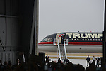 Republican front runner Donald Trump exits his private jet and descends the stairs to the tarmac at the Synergy Flight Center in Bloomington, Illinois on March 13, 2016.
