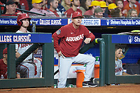 Arkansas Razorbacks head coach Dave Van Horn watches from the dugout during the game against the Texas Longhorns in game six of the 2020 Shriners Hospitals for Children College Classic at Minute Maid Park on February 28, 2020 in Houston, Texas. The Longhorns defeated the Razorbacks 8-7. (Brian Westerholt/Four Seam Images)