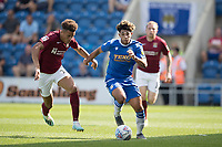 Courtney Senior of Colchester United breaks with Shaun McWilliams of Northampton Town in pursuit during Colchester United vs Northampton Town, Sky Bet EFL League 2 Football at the JobServe Community Stadium on 24th August 2019