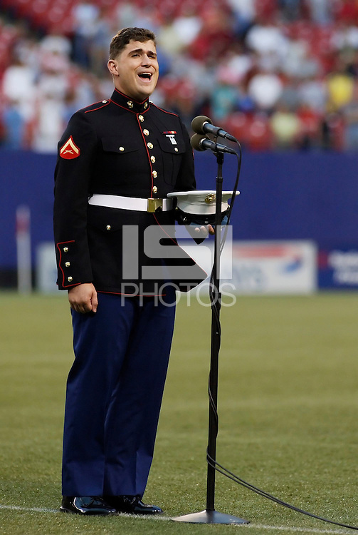 American Idol 4th place finisher Josh Gracin sings the National Anthem prior to the start of the game. The Chicago Fire were defeated by the NY/NJ MetroStars 2-1 at Giant's Stadium, East Rutherford, NJ, on July 24, 2004.