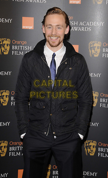 Tom Hiddleston.The Orange Wednesday Rising Star Award nominations launch, BAFTA, Piccadilly, London, England..January 11th, 2012.half length trousers hands in pockets blue tie black jacket goatee facial hair  .CAP/CAN.©Can Nguyen/Capital Pictures.
