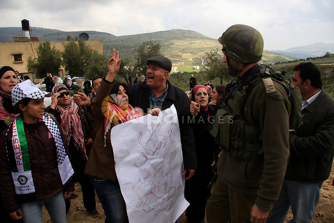 Palestinian women shout slogans during a women's demonstration in the West Bank village of Burin, near Nablus, Tuesday ,March 8, 2011. The protest was organized by Palestinian women to mark the International Women's Day and against the expansion of Israeli settlements. Photo by Wagdi Eshtayah