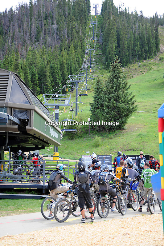 Mountain Bikers Getting on Chairlift at Winter Park, Colorado, USA