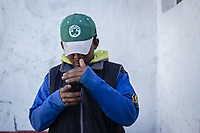 MEXICALI, MEXICO - February 20. A migrant checks his cellphone in the Alfa y Omega Shelter on February 20, 2019 in Mexicali, Mexico.<br />  A new group of Central American migrants arrived to the city, mostly young men. Some manifest their desire to remain on Mexican soil but for others the idea of crossing the border fence is still attractive.<br /> US President Donald Trump uses emergency powers to secure funding for his proposed US-Mexico border wall. In this case, Trump has claimed there is a migration crisis on the US-Mexico border.<br /> (Photo by Luis Boza/VIEWpress)