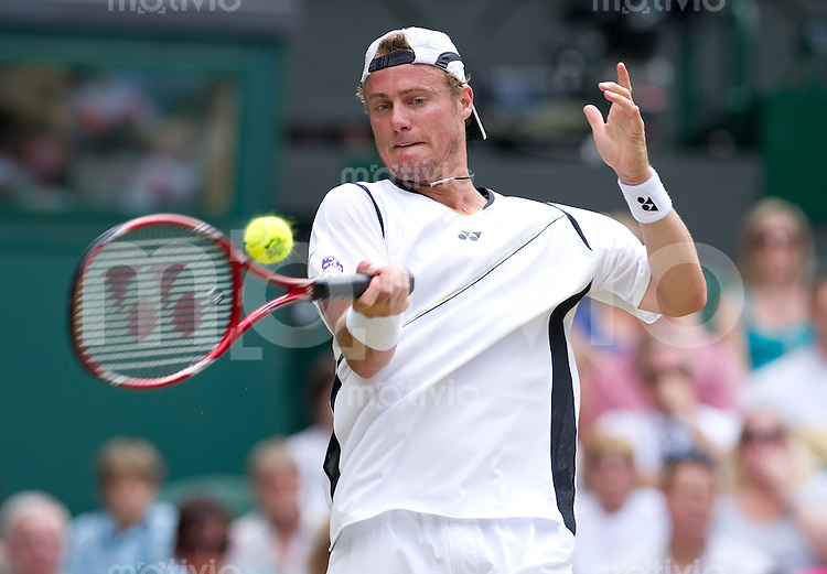 Lleyton Hewitt (AUS) plays against Gael Monfils (FRA) on Centre Court. The Wimbledon Championships 2010 The All England Lawn Tennis & Croquet Club  Day 5 Friday 25/06/2010