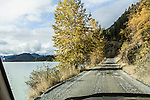 Lillouette Lake Road seen through the windshield in Autumn, near Lillouette BC, Canada.
