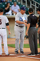 Pensacola Blue Wahoos manager Jody Davis (7) meets with Birmingham Barons manager Ryan Newman (5) and umpires Jose Navas (not pictured), Alex Mackay and Reid Joyner at home plate before a game against the Birmingham Barons on May 8, 2018 at Regions Field in Birmingham, Alabama.  Birmingham defeated Pensacola 5-2.  (Mike Janes/Four Seam Images)