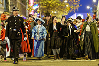 "Pictured: Actress Michelle McTernan (C) with locals dressed as festive characters lead the Christmas parade in Swansea, Wales, UK. Sunday 19 November 2018<br /> Re: Swansea Christmas parade attended by thousands has been branded a ""shambles"" for having just three floats.<br /> The annual festive event in south Wales, which took place on Sunday, promised ""dynamic dance-troupes"" as well as ""spectacular shows and stages"".<br /> But the parade was scaled down, leading to a barrage of criticism on social media because of roadworks in the city centre. <br /> The leader of Swansea Council, Rob Stewart apologised on Facebook and said the parade was not ""good enough"".<br /> Parents took on social media to voice their anger, calling the event ""a load of rubbish"" and claiming there was nothing for young children apart from ""a loud music float with Santa on""."