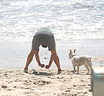 4-19-09. Exclusive .Matthew McConaughey running jogging with his dog at the beach in Malibu ca .Doing a little stretching while watching the waves...AbilityFilms@yahoo.com.805-427-3519.www.AbilityFilms.com.