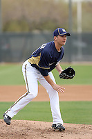 Brandon Kintzler #61 of the Milwaukee Brewers participates in pitchers fielding practice during spring training workouts at the Brewers complex on February 18, 2011  in Phoenix, Arizona. .Photo by Bill Mitchell / Four Seam Images.