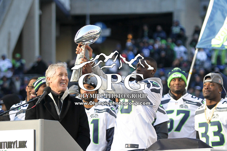 2014-02-05:  Seattle Seahawks Jeremy Lane showed off the Super Bowl Trophy on Stage. Seattle Seahawks players and 12th man fans celebrated bringing the Lombardi trophy home to Seattle during the Super Bowl Parade at Century Link Field in Seattle, WA.